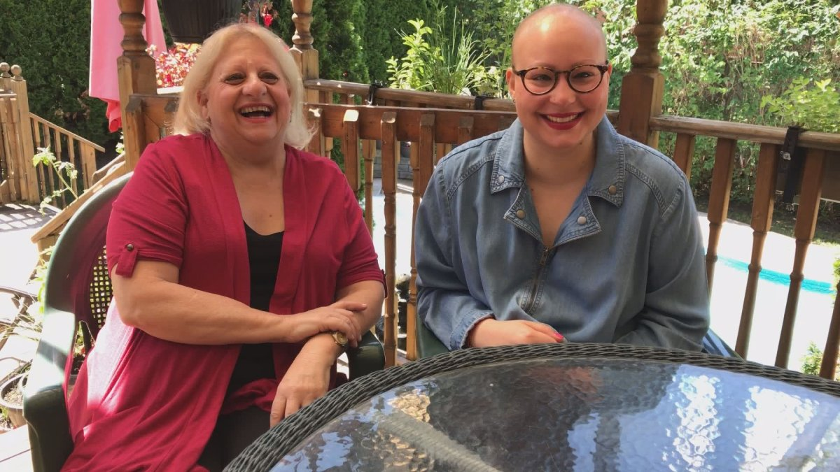 Mother and daughter Merle and Lindsey Finklestein, who are both fighting breast cancer, pose for a picture at their home, Thursday, June 22, 2017.