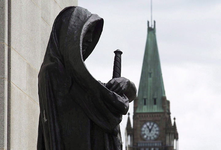 The Peace tower on Parliament Hill is seen behind the justice statue outside the Supreme Court of Canada in Ottawa, Monday June 6, 2016.