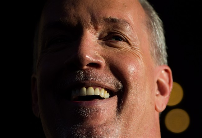 British Columbia Premier-designate, NDP Leader John Horgan smiles while speaking outside Government House after meeting with Lt-Gov. Judith Guichon in Victoria, B.C., on Thursday, June 29, 2017.