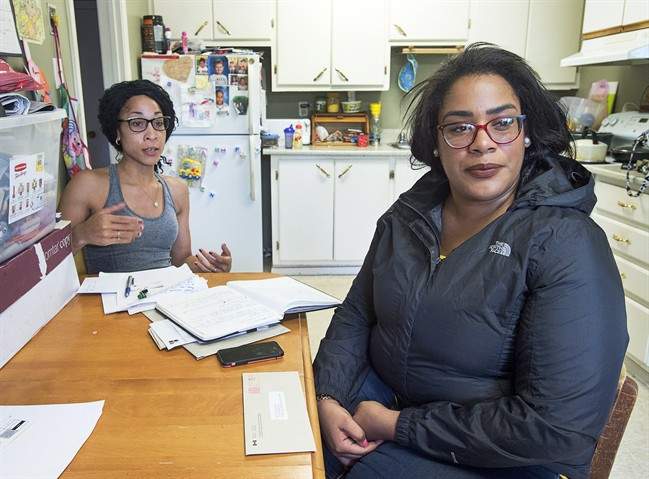 Cassandra Desmond, left, and her sister Chantel Desmond are seen in Antigonish, N.S. on Wednesday, June 14, 2017. Their brother, Lionel Desmond, a 33-year-old veteran of the war in Afghanistan who suffered from post-traumatic stress disorder, took his own life after shooting his 52-year-old mother, his wife Shanna, 31, and their 10-year-daughter Aaliyah.