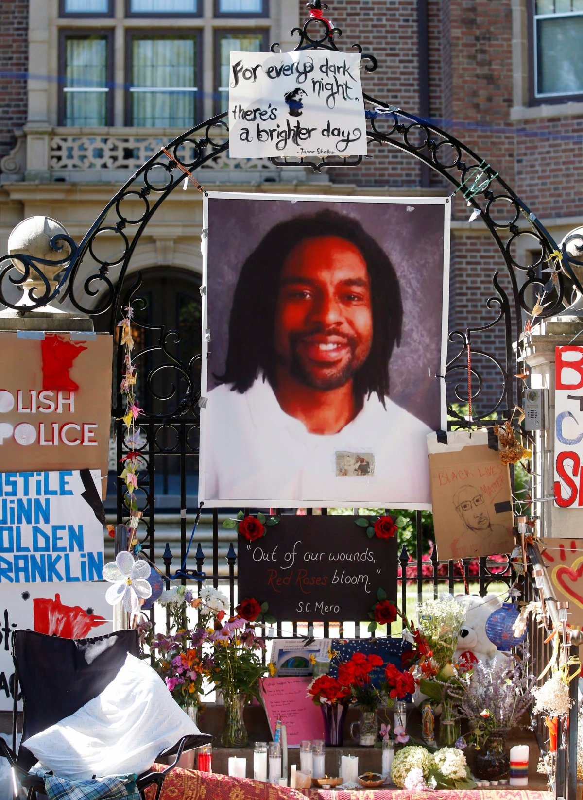 In this July 25, 2016, file photo, a memorial including a photo of Philando Castile adorns the gate to the governor's residence where protesters demonstrated in St. Paul, Minn., against the July 6 shooting death of Castile by St. Anthony police Officer Jeronimo Yanez during a traffic stop in Falcon Heights, Minn.