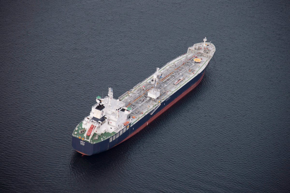 A tanker is anchored in Burrard Inlet just outside of Burnaby, B.C., on Friday, Nov. 25, 2016. The Federal Government is expected to announce their decision if they will allow the expansion of the pipeline or not any day.