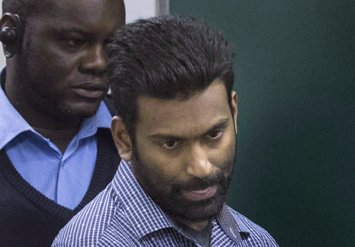 Sivaloganathan Thanabalasingam arrives for a detention review at the Immigration and Refugee Board of Canada in Montreal, Thursday, April 13, 2017. The first murder suspect in Quebec to be set free after the length of his criminal proceedings exceeded the legal limit told immigration and refugee authorities Thursday he wants to be deported back to Sri Lanka.