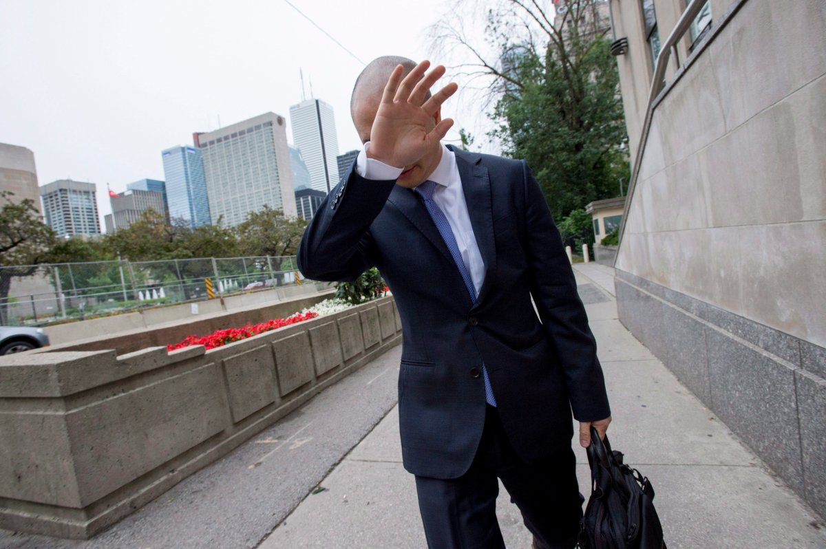 Sears Canada Chief Financial Officer Billy Wong walks away from the Ontario Superior Court in Toronto on Thursday, July 13, 2017.