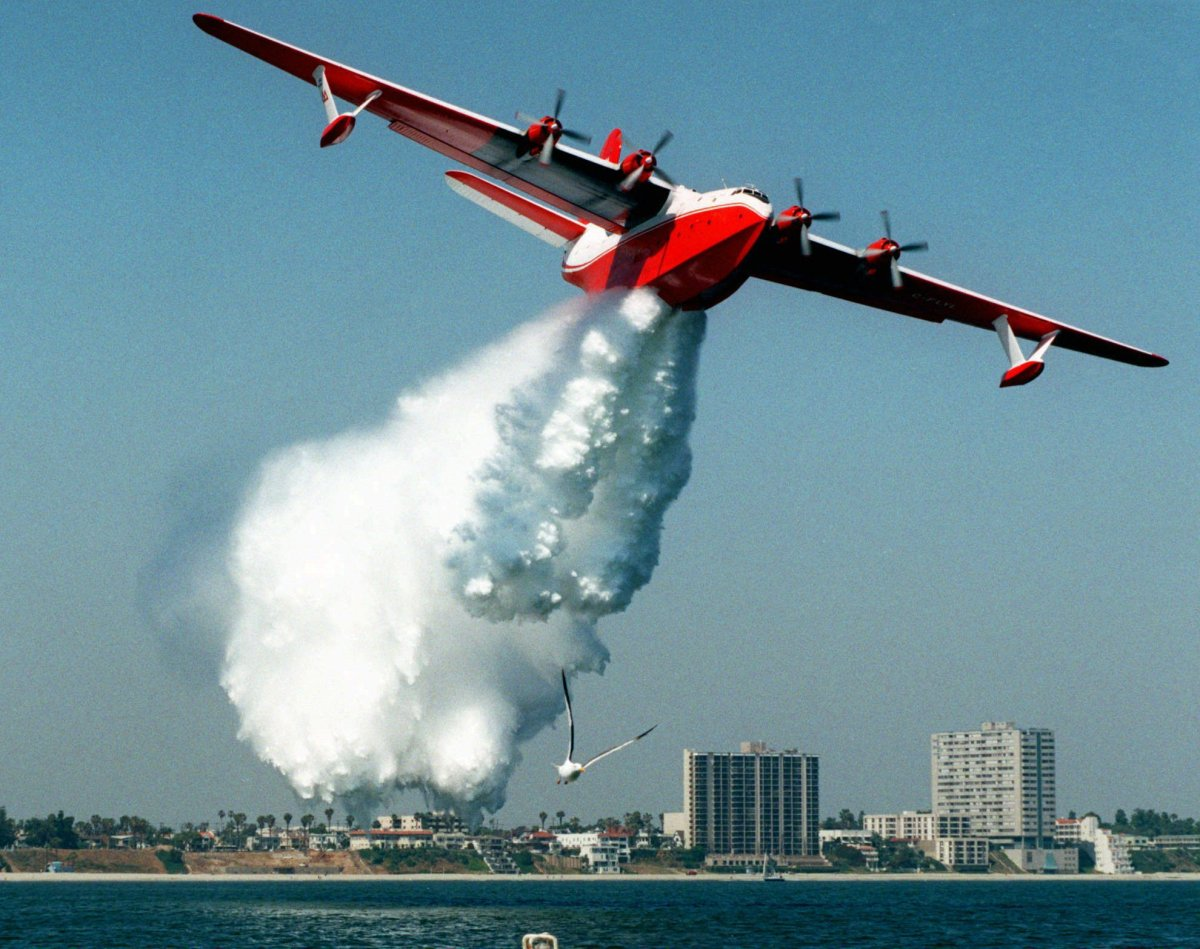 A Martin Mars flying boat water bomber makes a demonstration drop of some 7,200 gallons of water off the shore of Long Beach, Calif., in this Thursday, June 18, 1998 file photo.