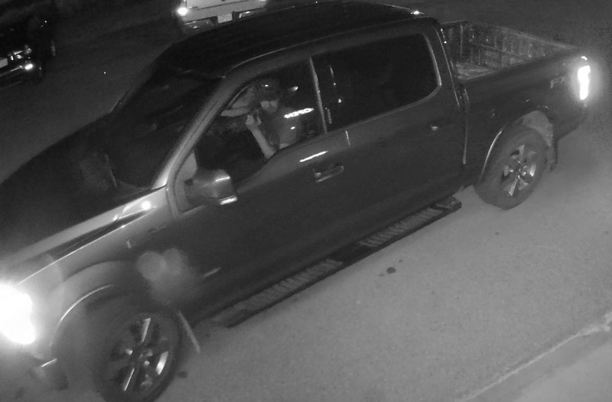 Photo from Red Deer RCMP showing a man driving a Ford truck suspected of being used in the theft on Monday, July 3, 2017.