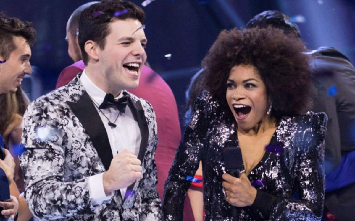 Kevin Martin, left, takes the 'Big Brother Canada' Season 5 crown beside host Arisa Cox.