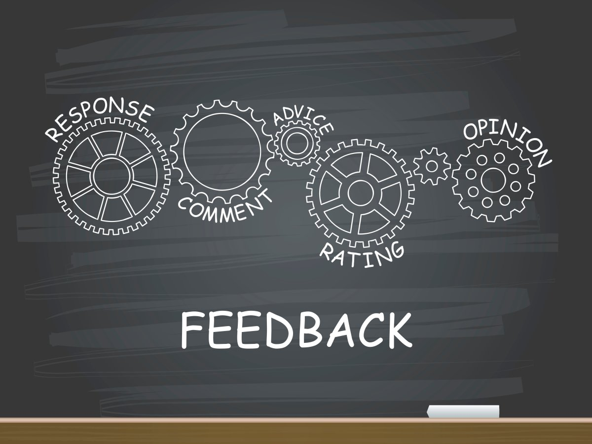 Feedback with gear concept on chalkboard. Vector illustration.