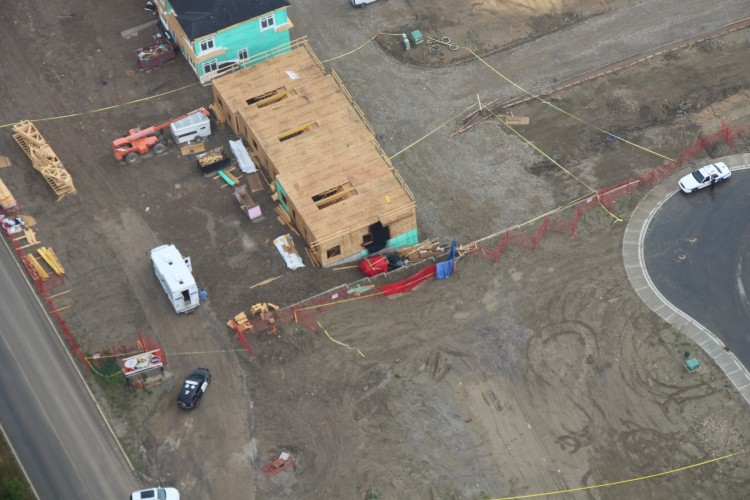 An aerial view of the scene of the discovery of three bodies inside a burning car in Calgary on July 10, 2017.