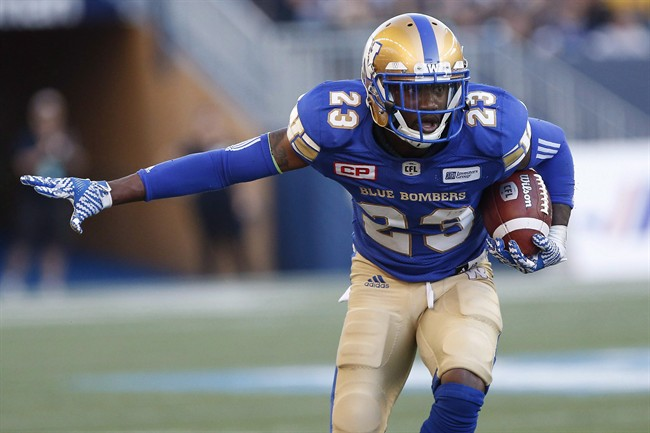 Winnipeg Blue Bombers' TJ Heath (23) runs the ball after an interception against the Calgary Stampeders during the first half of CFL action in Winnipeg Friday, July 7, 2017.