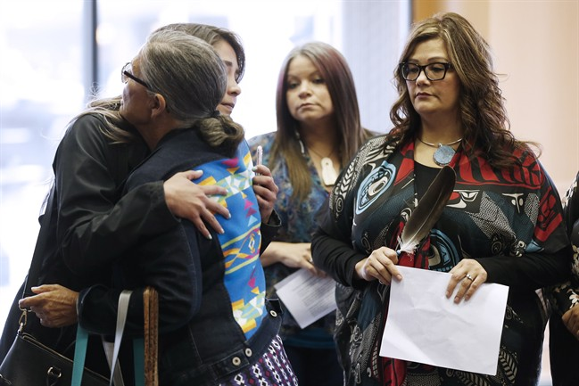 Family members of the Missing and Murdered Indigenous Women and Girls (MMIWG) and Coalition Co-chairs greet each other prior to a press conference calling for a re-organization of the National Inquiry into Missing and Murdered Indigenous Women and Girls in Winnipeg, Wednesday.