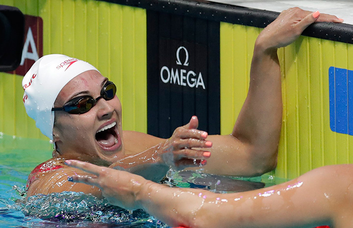 Canada's gold medal winner Kylie Masse celebrates after setting a new world record in the women's 100-metre backstroke final at the World Aquatics Championships in Budapest, Hungary, Tuesday, July 25, 2017.