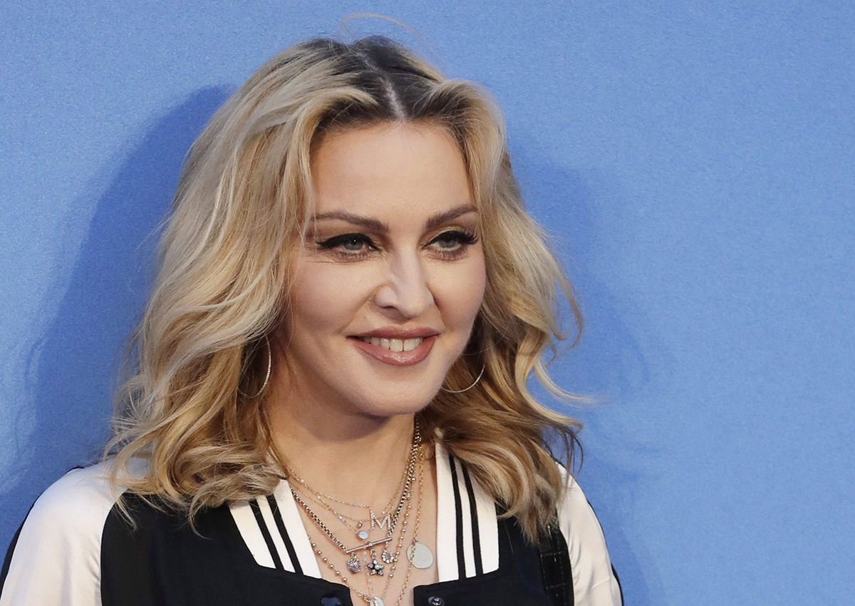 """In this Sept. 15, 2016 file photo, Madonna poses for photographers upon arrival at the World premiere of the film """"The Beatles, Eight Days a Week"""" in London."""