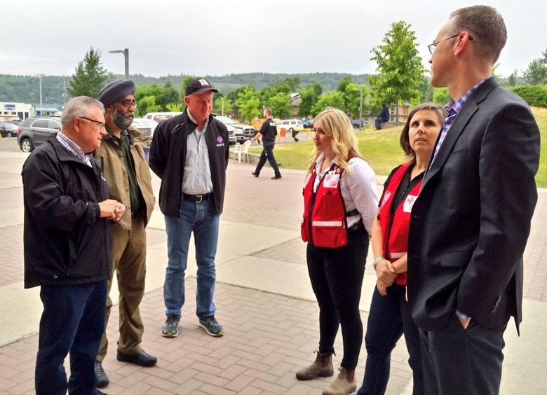 Federal ministers Ralph Goodale and Harjit Sajjan, along with B.C. minister of public safety Mark Farnsworth, meet with representatives of the Canadian Red Cross in Kamloops on Saturday, July 22.