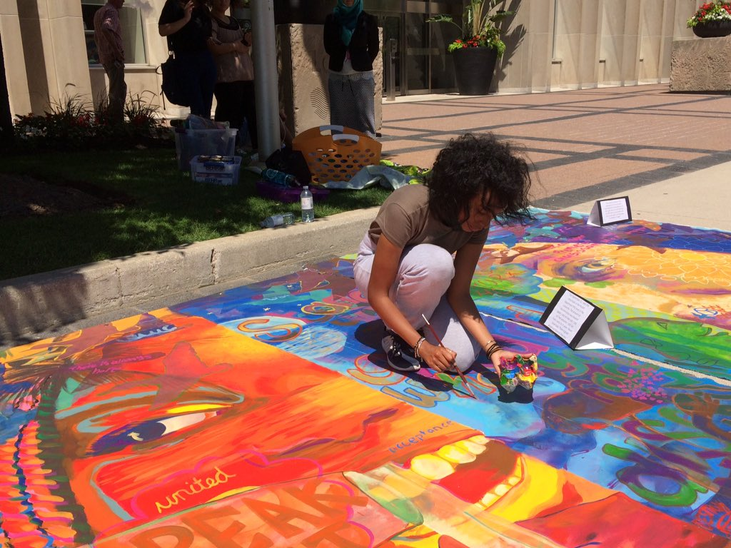 Shirug Faraj helps blend new elements added to the canvas, on July 19, 2017.