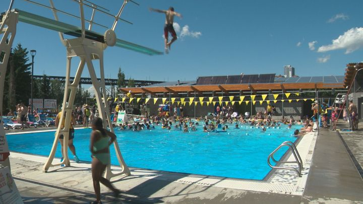 People enjoy the sun and water at Queen Elizabeth Outdoor Pool Tuesday, July 4, 2017.