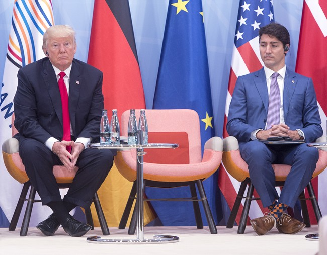 Prime Minister Justin Trudeau, right, and United States President Donald Trump take part in a Women and Development event at the G20 summit Saturday, July 8, 2017 in Hamburg, Germany.
