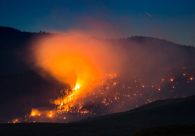 A wildfire burns on a mountain near Ashcroft, B.C., late Friday July 7, 2017. More than 3,000 residents have been evacuated from their homes in central British Columbia. A provincial state of emergency was declared after 56 new wildfires started Friday.