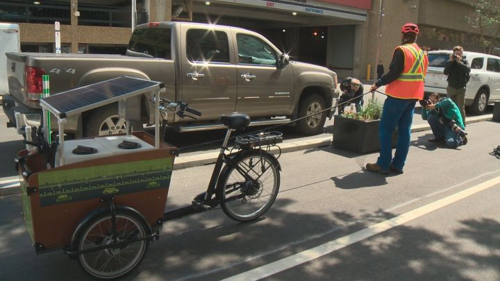 Edmonton is using two solar-powered watering trikes to water the 100 planters along Edmonton's downtown bike network.