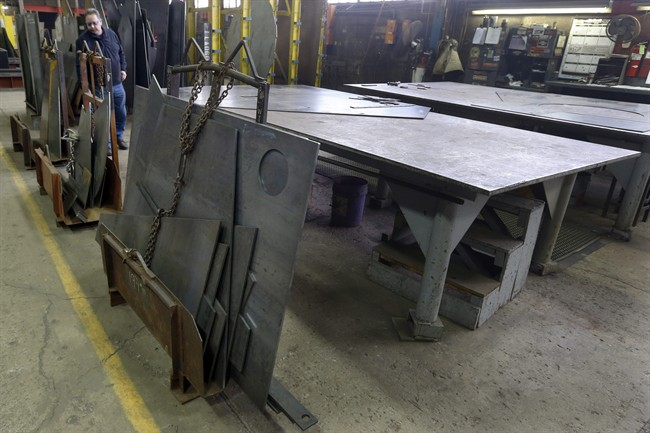 In this photo taken Feb. 12, 2015, cut panels of steel used to make blades to build fans for industrial ventilation systems are stored on the production floor in Harmony, Pa. President Donald Trump pledged during the campaign to help U.S. factory workers by slapping tariffs on foreign steel, but his long-awaited decision on the issue is running behind schedule.