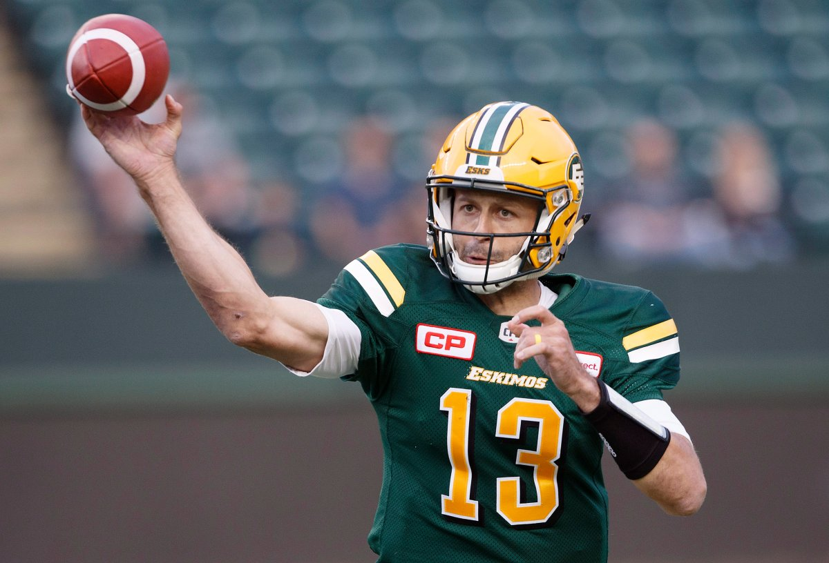 Edmonton Eskimos quarterback Mike Reilly (13) makes the throw against the Hamilton Tiger-Cats during first half CFL action in Edmonton, Alta., on Friday August 4, 2017.