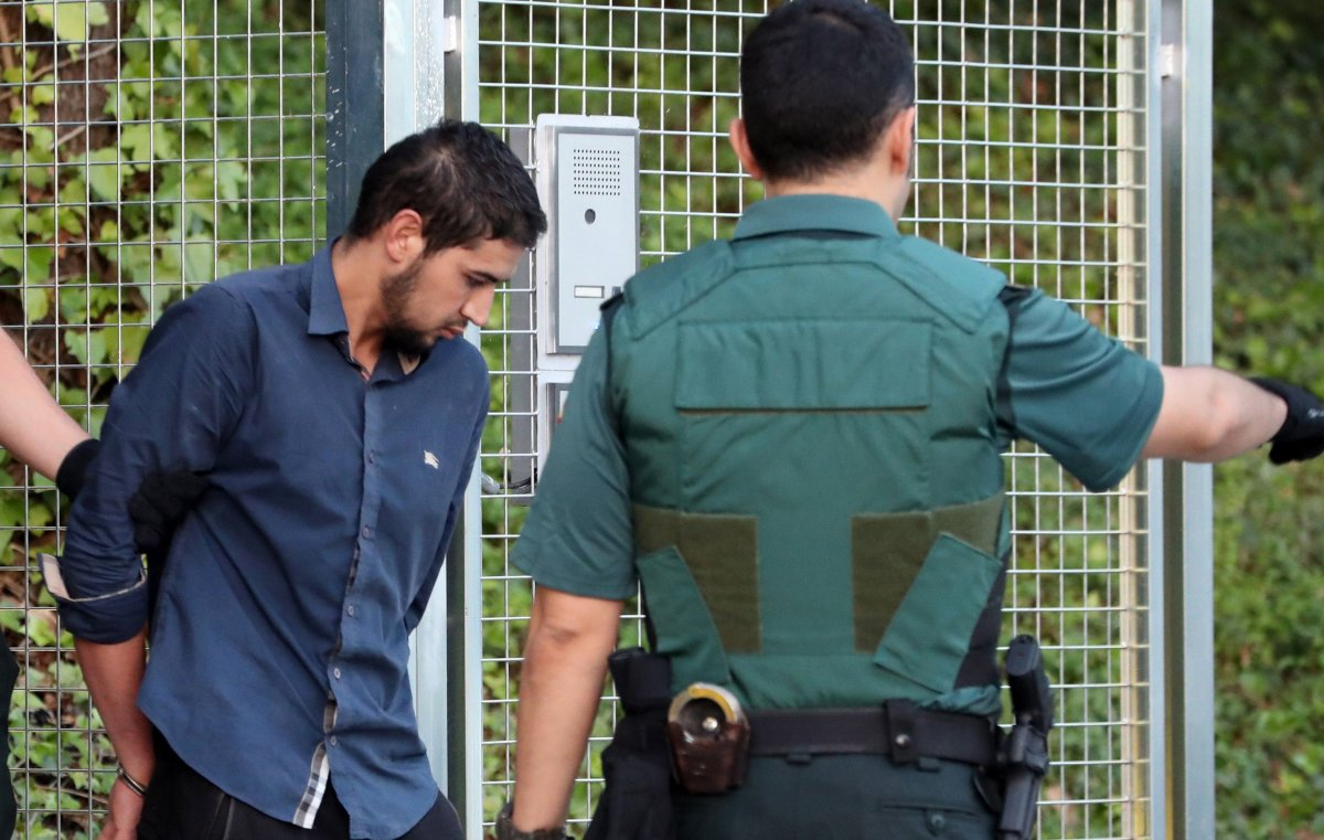 Salah El Karib, 34, one of four arrested in relation to the terrorist attacks in Catalonia, is taken to the Audiencia Nacional court in Madrid, Spain, 22 August 2017.