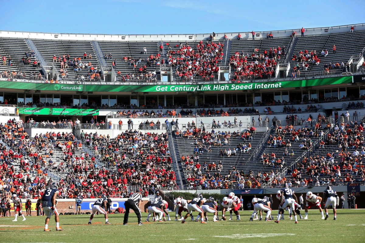 In this Oct. 29, 2016, file photo Louisville lines up for a play against Virginia during an NCAA college football game in Charlottesville, Va.
