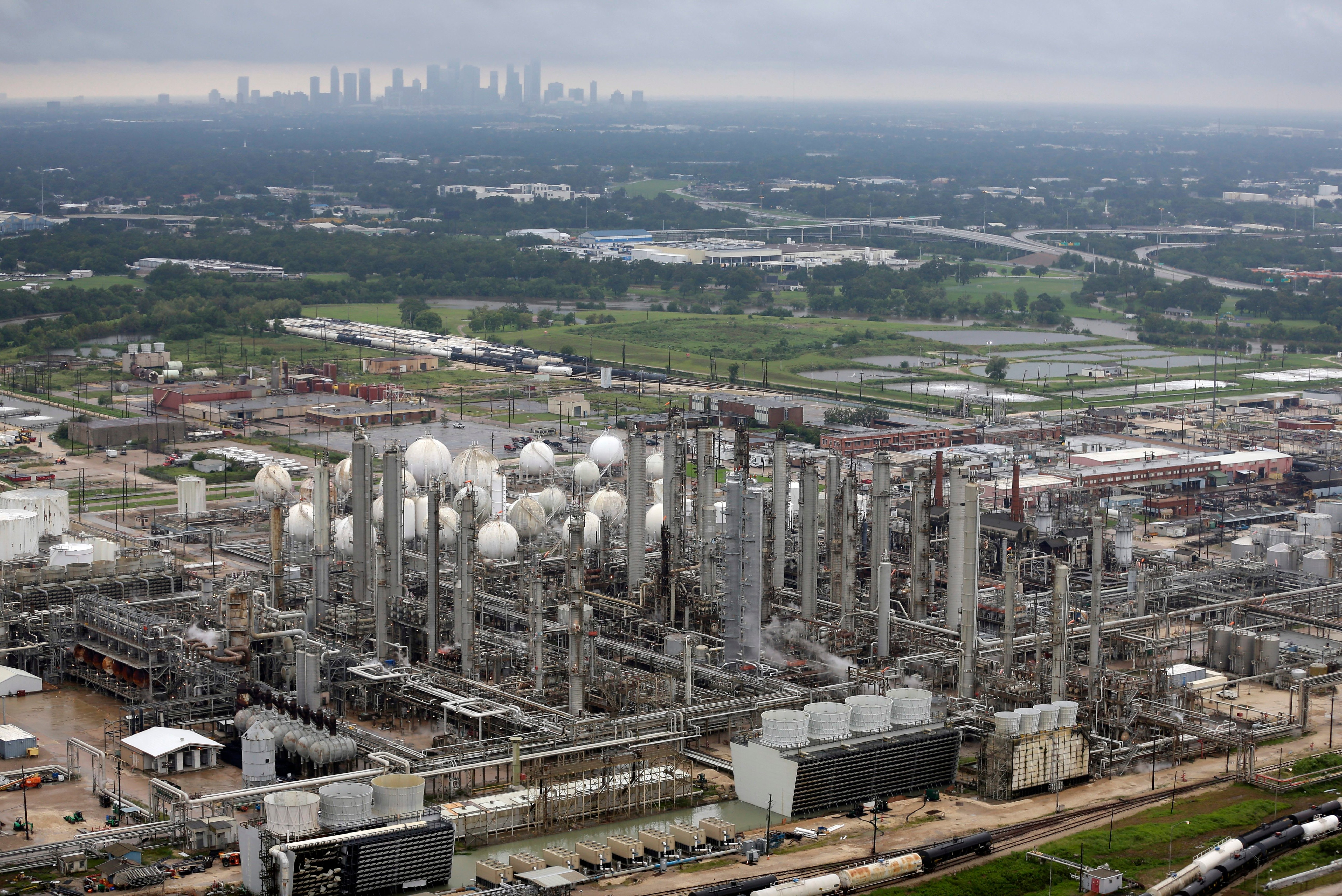 FILE: An aerial photo showing the TPC petrochemical plant near downtown Houston, background, on Tuesday, Aug. 29, 2017.
