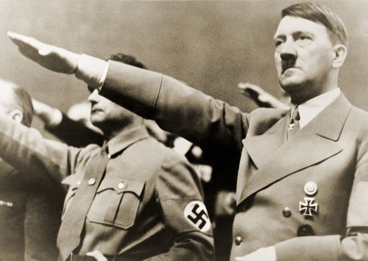Adolf Hitler, giving Nazi salute. To Hitler's right is Rudolph Hesse. 1939.
