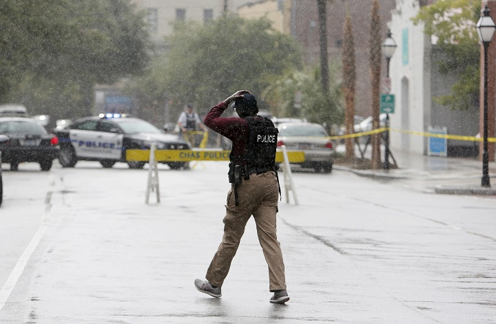 Charleston, S.C. Police Department blocks the street during an active hostage situation in Charleston, S.C., on Thursday, Aug.24, 2017.  Authorities say a disgruntled former employee shot one person and held hostages in a restaurant in an area that is popular with tourists, before being shot by police.