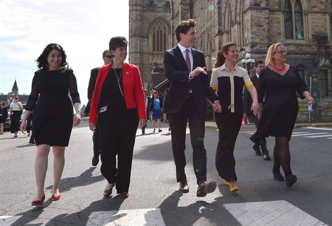 Status of Women Minister Maryam Monsef, left to right, Minister of International Development and La Francophonie Marie-Claude Bibeau, Prime Minister Justin Trudeau, Sophie Gregoire Trudeau and Women Deliver President and CEO Katja Iversen arrive at an event in Ottawa on Tuesday, June 13, 2017. The Liberal government is thinking about using its massive purchasing power to support women in business.