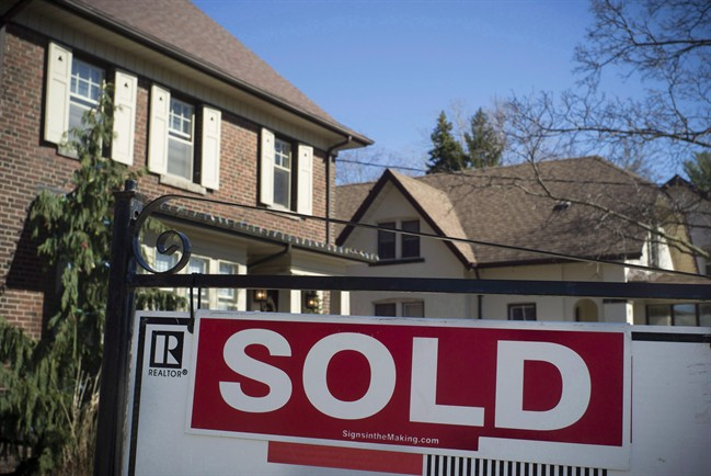 A sold sign is shown in front of west-end Toronto homes, Sunday, April 9, 2017.