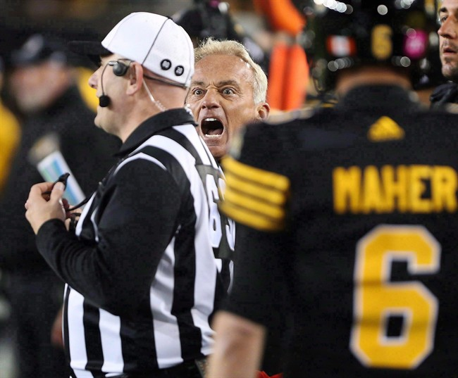 Jeff Reinebold yells at a referee following an attempted on-side kick by the Hamilton Tiger-Cats against the Edmonton Eskimos on October 28, 2016. The winless Ticats shook up their coaching staff on Tuesday by replacing defensive co-ordinator Reinebold.