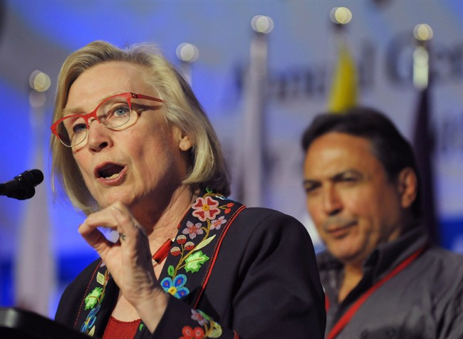 Minister of Indigenous and Northern Affairs, Carolyn Bennett speaks as AFN National Chief Perry Bellegarde looks on at the Assembly of First Nations annual general meeting in Regina, Sask., Tuesday July 25, 2017. Bennett says she's troubled by reports of Indigenous women in and around Saskatoon being coerced into tubal ligation procedures.