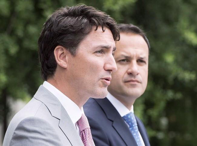 Prime Minister Justin Trudeau, left, speaks to the media as Irish Taoiseach Leo Varadkar looks on at Farmleigh House, on Tuesday, July 4, 2017, in Dublin.