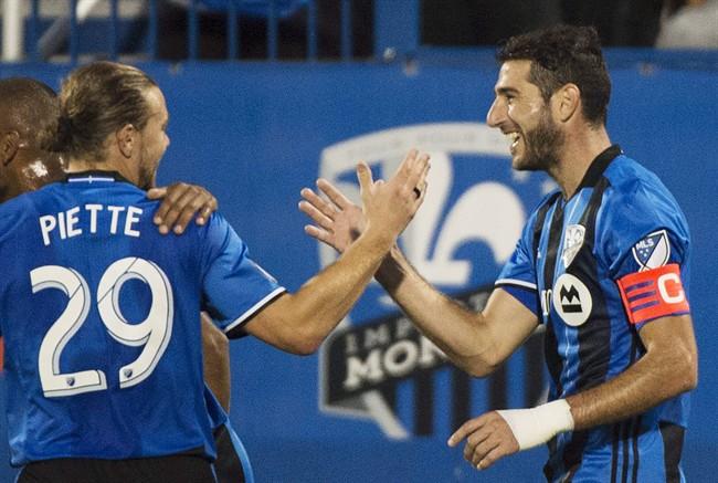 Montreal Impact's Ignacio Piatti, right, celebrates with teammate Samuel Piette.