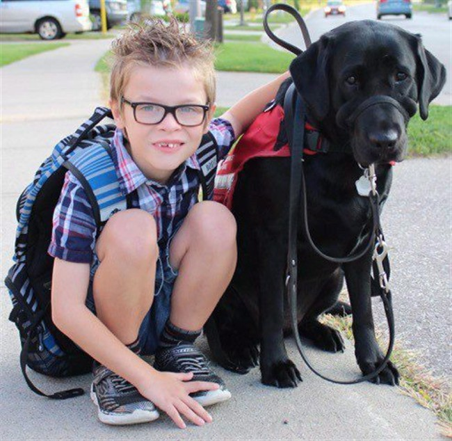 Kenner Fee poses with his service dog Ivy in an undated handout photo.