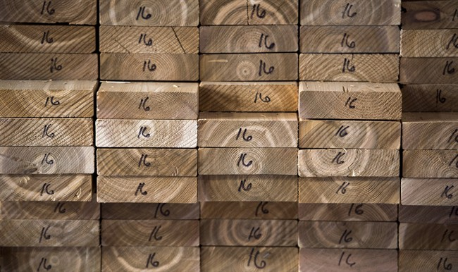 Cedar planks are stacked at a lumber yard, Tuesday, April 25, 2017 in Montreal.