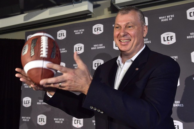 CFL commissioner Randy Ambrosie tosses a football as he speaks during a press conference in Toronto, Wednesday July 5, 2017.