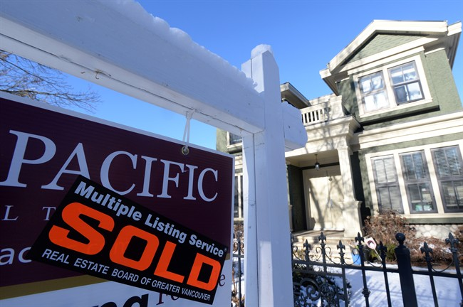 A real estate sold sign is shown outside a house in Vancouver, Tuesday, Jan.3, 2017. The Real Estate Board of Greater Vancouver says the typical price of a home in Metro Vancouver has surpassed $1 million.