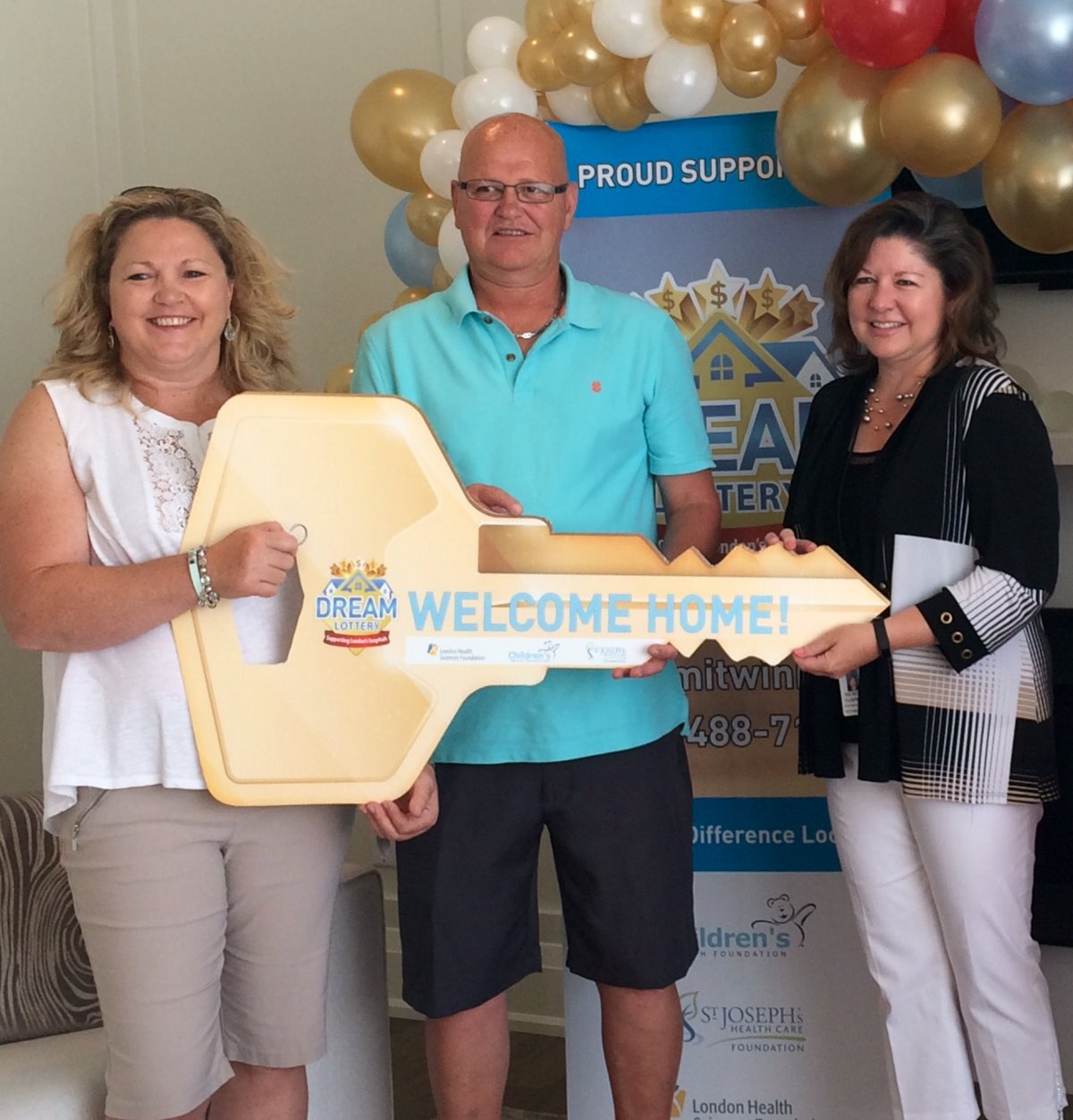 From left to right: Denise Neal and Dermot Brennan, the winners of the spring edition of the Dream Lottery, and Michelle Campbell, the President and CEO of St. Joseph's Health Care Foundation.