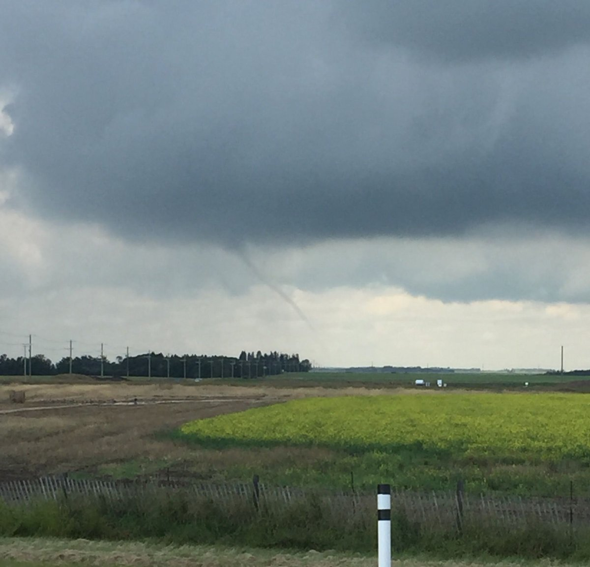 A funnel cloud spotted near Leduc Saturday afternoon shortly after a weather advisory was issued.