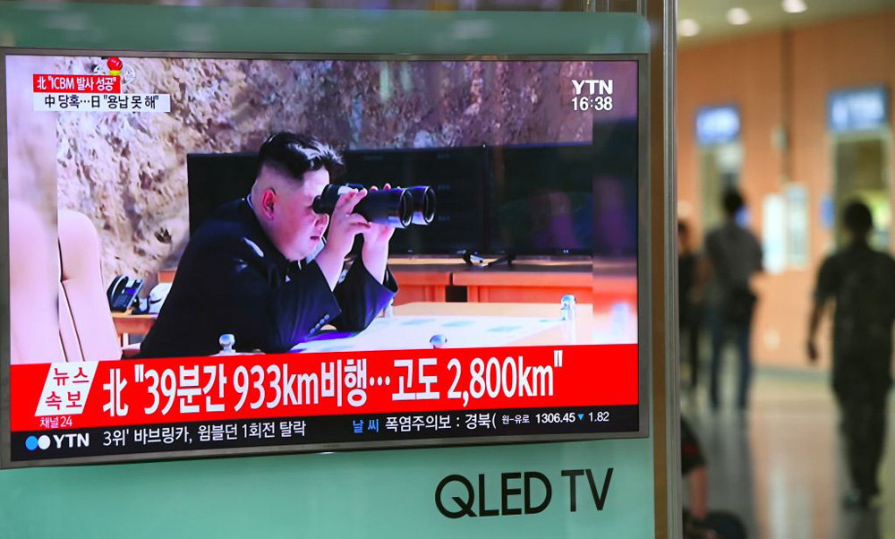 A television screen  at a railway station in Seoul shows a picture of North Korean leader Kim Jong-Un watching the country's test launch of an intercontinental ballistic missile.