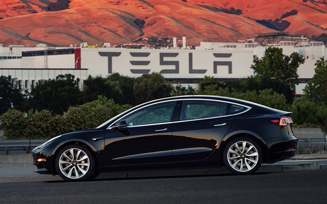 This file image provided by Tesla Motors shows the Tesla Model 3 sedan.