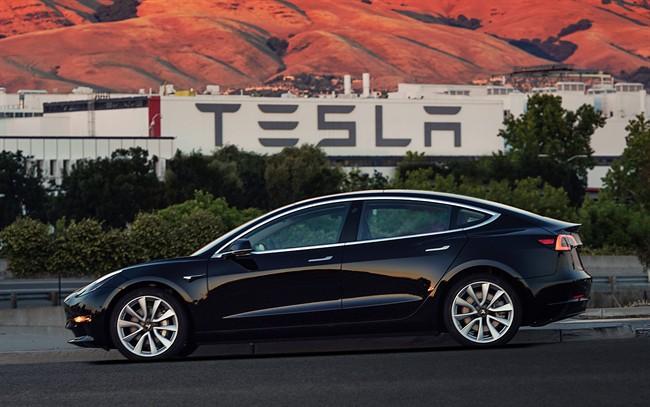 This file image provided by Tesla Motors shows the Tesla Model 3 sedan.