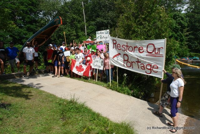 Protesters gathered at Moore Falls to protest the closure of an under-highway portage between Gull Lake and Moore Lake.