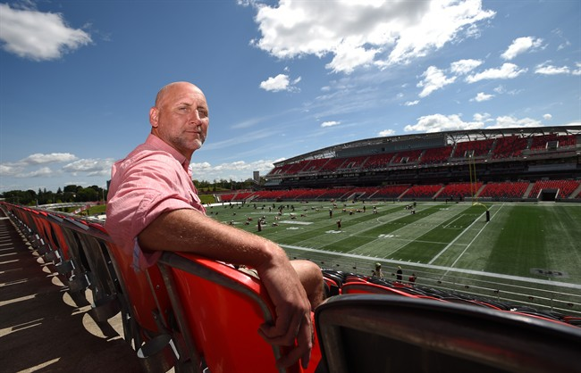 Former CFL player Ken Evraire poses for a photo at TD Place in Ottawa on Wednesday, Aug. 16, .