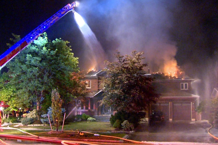 Firefighters battle a two-alarm blaze at a residence in Vaughan on Aug. 30, 2017.
