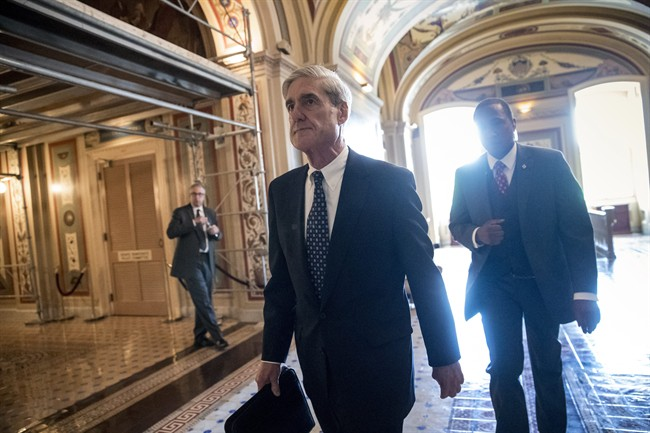 Special Counsel Robert Mueller departs after a closed-door meeting with members of the Senate Judiciary Committee about Russian meddling in the election at the Capitol in Washington.