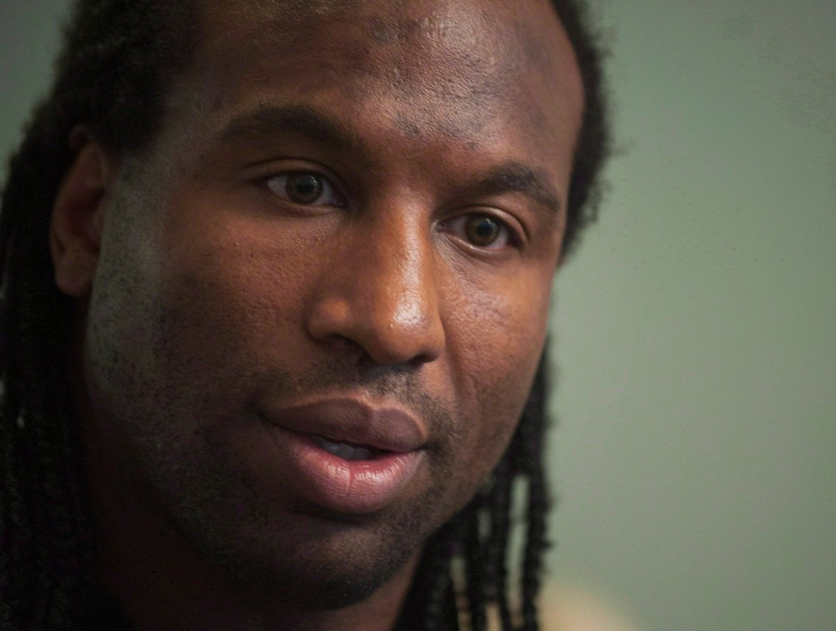 FILE: Former NHL tough guy Georges Laraque speaks at a news conference in Montreal, Friday, October 18, 2013.